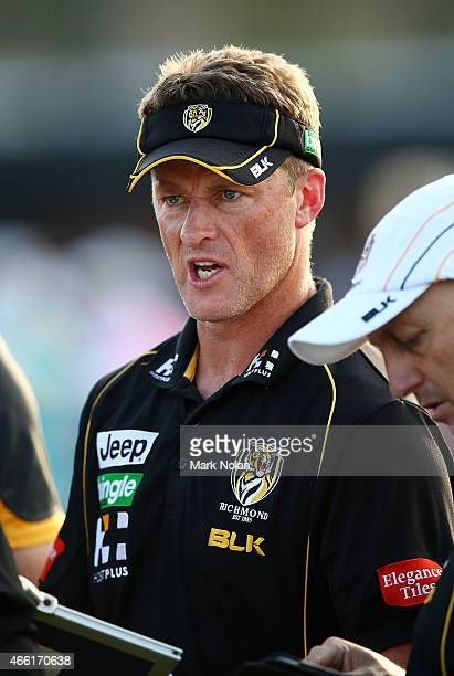 Tigers coach Damien Hardwick chats with other coaching staf in a break during the NAB Challenge AFL match between the Richmond Tigers and Port...