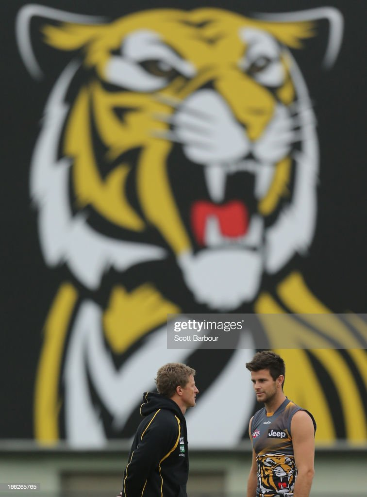 Tigers coach Damien Hardwick (L) talks with Trent Cotchin during a Richmond Tigers AFL Training session at ME Bank Centre on April 11, 2013 in Melbourne, Australia.