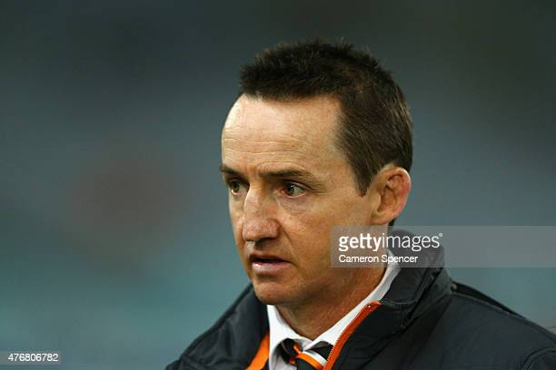 Tigers coach Jason Taylor looks on during the round 14 NRL match between the Wests Tigers and the South Sydney Rabbitohs at ANZ Stadium on June 12...