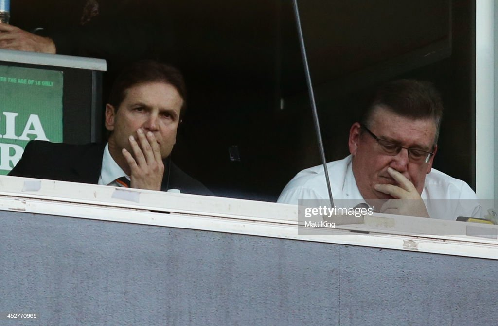 Tigers coach Mick Potter (L) looks dejected during the round 20 NRL match between the Wests Tigers and the St George Illawarra Dragons at ANZ Stadium on July 27, 2014 in Sydney, Australia.