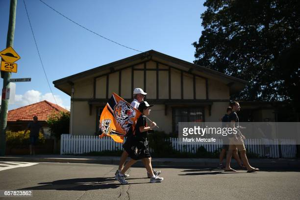 Tigers fans arrive for the round four NRL match between the Wests Tigers and the Melbourne Storm at Leichhardt Oval on March 26 2017 in Sydney...