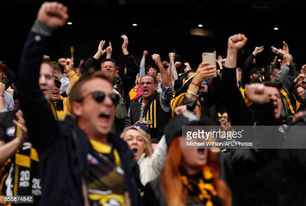 Tigers fans celebrate during the 2017 Toyota AFL Grand Final match between the Adelaide Crows and the Richmond Tigers at the Melbourne Cricket Ground...