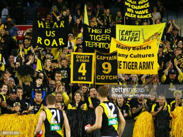 Tigers fans celebrate the win during the 2018 AFL round five match between the Melbourne Demons and the Richmond Tigers at the Melbourne Cricket...