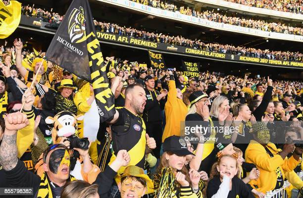 Tigers fans celebrate winning the 2017 AFL Grand Final match between the Adelaide Crows and the Richmond Tigers at Melbourne Cricket Ground on...