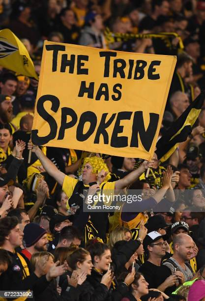 Tigers fans celebrate winning the round five AFL match between the Richmond Tigers and the Melbourne Demons at Melbourne Cricket Ground on April 24...