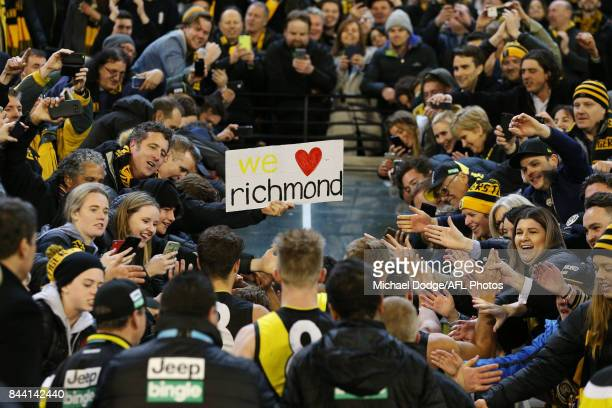Tigers fans celebrates the win during the AFL Second Qualifying Final Match between the Geelong Cats and the Richmond Tigers at Melbourne Cricket...