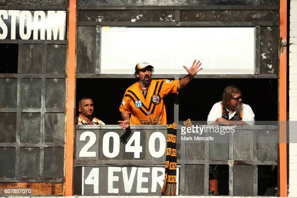 Tigers fans cheer from the scoreboard during the round four NRL match between the Wests Tigers and the Melbourne Storm at Leichhardt Oval on March 26...