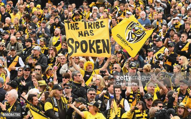 Tigers fans cheer their team on stage as they celebrate winning yesterday's AFL Grand Final at Punt Road Oval on October 1 2017 in Melbourne Australia