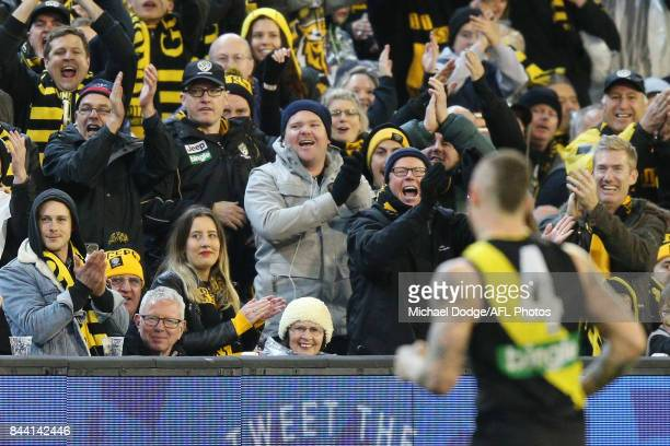 Tigers fans clap off Dustin Martin of the Tigers during the AFL Second Qualifying Final Match between the Geelong Cats and the Richmond Tigers at...