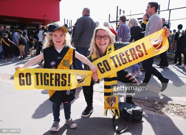 Tigers fans pose during a Richmond Tigers AFL training session at Punt Road Oval on September 22 2017 in Melbourne Australia