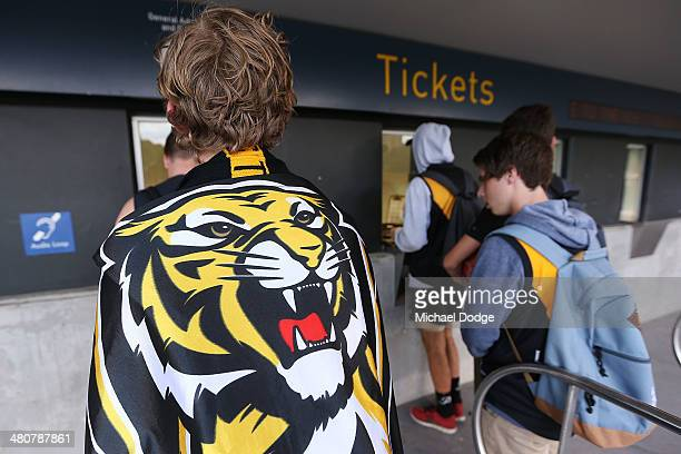 Tigers fans que up for tickets during the round two AFL match between the Richmond Tigers and the Carlton Blues at Melbourne Cricket Ground on March...