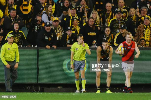 Tigers fans react after a ree kick was awarded to Josh Green of the Bombers in the goal square after a rush behind during the round 10 AFL match...