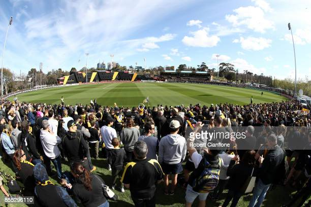 Tigers fans watch a Richmond Tigers AFL training session at Punt Road Oval on September 29 2017 in Melbourne Australia
