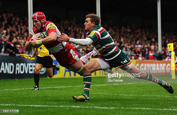 Tigers flyhalf Toby Flood cant stop Gloucester captain Luke Narraway from scoring during the Aviva Premiership match between Gloucester and Leicester...