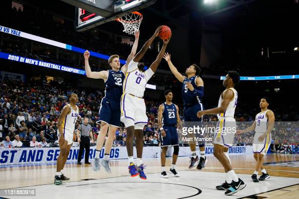 Tigers forward Naz Reid shoots the ball as Yale Bulldogs forward Blake Reynolds defends in the first round of the 2019 NCAA Photos via Getty Images...