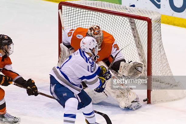 Tigers goalie Mike Rotolo deflects the puck off his skate which was shot by Air Force Falcons forward Jordan Himley during the game between the Air...