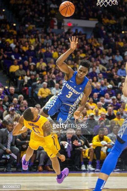 Tigers guard Brandon Sampson draws a charge on University of Kentucky guard Hamidou Diallo during a basketball game between the Kentucky Wildcats and...