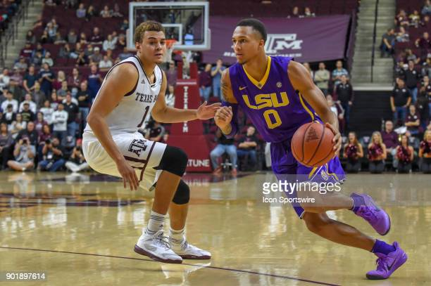 Tigers guard Brandon Sampson drives to the basket from the wing as Texas AM Aggie forward DJ Hogg defends during the basketball game on January 6...