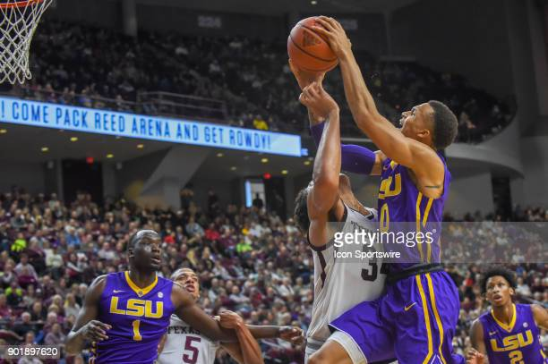 Tigers guard Brandon Sampson is fouled by Texas AM Aggie center Tyler Davis as he drives hard to the basket during first half action during the...