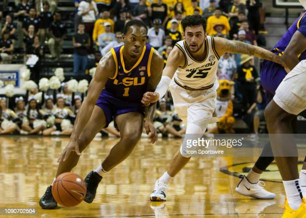 Tigers guard Ja'vonte Smart attempts to drive around the defense of Missouri Tigers guard Jordan Geist during the SEC conference game between the...