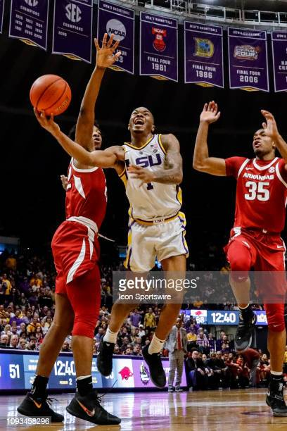Tigers guard Ja'vonte Smart drives to the basket against Arkansas Razorbacks forward Reggie Chaney on February 02 at Pete Maravich Assembly Center in...