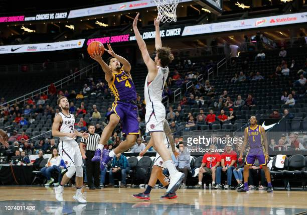 Tigers guard Ja'vonte Smart takes a shot against St Mary's Gaels center Jordan Hunter during the Neon Hoops Showcase Saturday Dec 15 at TMobile Arena...