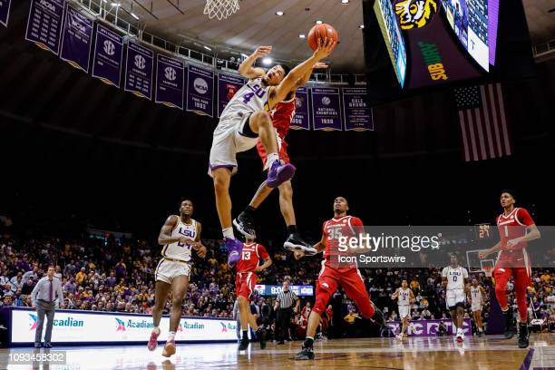 Tigers guard Skylar Mays is fouled by Arkansas Razorbacks guard Jalen Harris going to the basket on February 02 at Pete Maravich Assembly Center in...