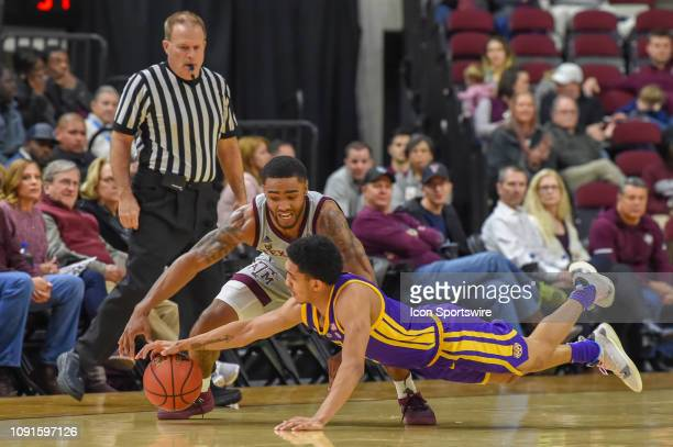 Tigers guard Tremont Waters dives for a steal off of Texas AM Aggies guard TJ Starks during second half action during the basketball game between the...