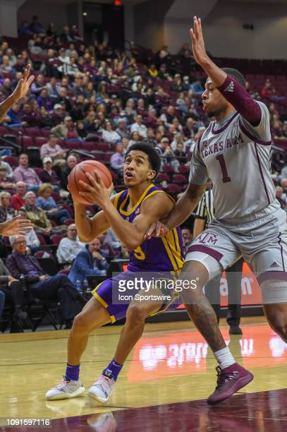 Tigers guard Tremont Waters drives to the basket as Texas AM Aggies guard Savion Flagg defends during second half action during the basketball game...