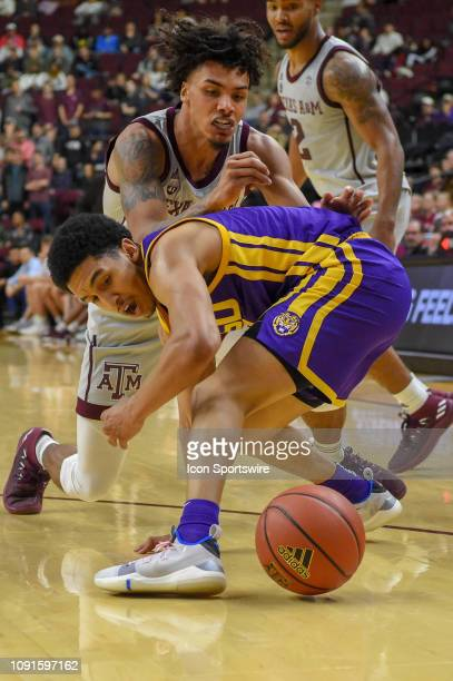 Tigers guard Tremont Waters fights for a loose ball with Texas AM Aggies guard Brandon Mahan during second half action during the basketball game...