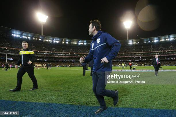 Tigers head coach Damien Hardwick and Cats head coach Chris Scott speak togther after the line up during the AFL Second Qualifying Final Match...