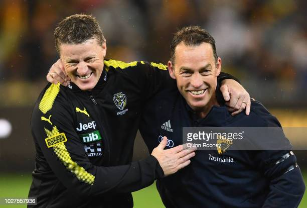 Tigers head coach Damien Hardwick and Hawks head coach Alastair Clarkson hug before the start of the AFL First Qualifying Final match between the...