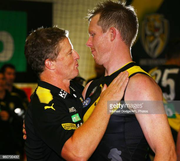 Tigers head coach Damien Hardwick and Jack Riewoldt of the Tigers celebrate the win during the 2018 AFL round five match between the Melbourne Demons...