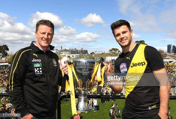 Tigers head coach Damien Hardwick and Trent Cotchin of the Tigers pose with the Premiership Trophy during the Richmond Tigers Post AFL Grand Final...