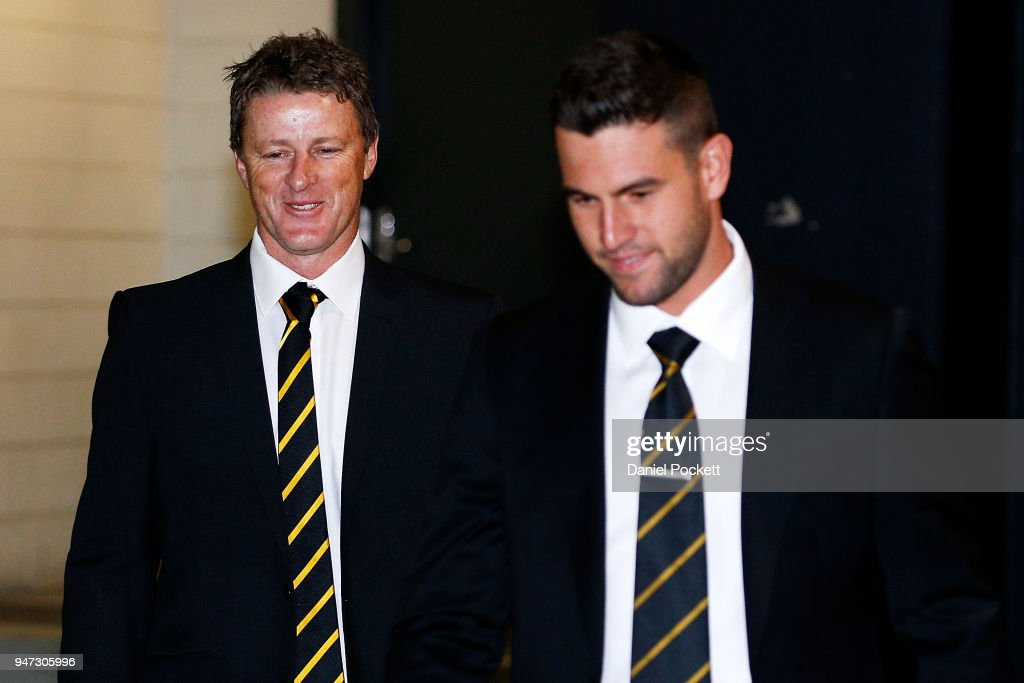 Tigers head coach Damien Hardwick arrives with Jack Graham of the Tigers at the AFL Tribunal on April 17, 2018 in Melbourne, Australia.