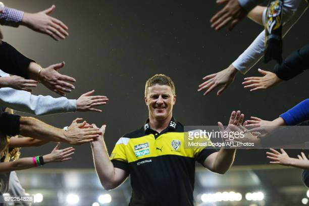 Tigers head coach Damien Hardwick celebrates the win with fans during the round five AFL match between the Richmond Tigers and the Melbourne Demons...