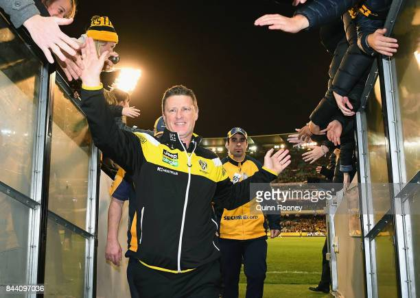 Tigers head coach Damien Hardwick high fives fans after winning the AFL Second Qualifying Final Match between the Geelong Cats and the Richmond...