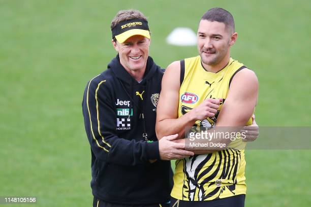 Tigers head coach Damien Hardwick hugs Shaun Grigg of the Tigers during a Richmond Tigers AFL training session at Punt Road Oval on May 10, 2019 in...