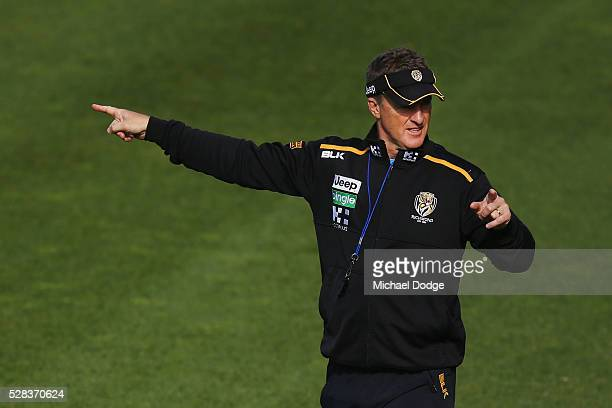 Tigers head coach Damien Hardwick points in two different directions during a Richmond Tigers AFL training session at Punt Road Oval on May 5 2016 in...