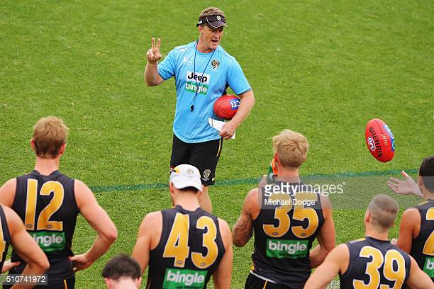 Tigers head coach Damien Hardwick speaks to his players during a Richmond Tigers AFL media session at Punt Road Oval on February 17 2016 in Melbourne...