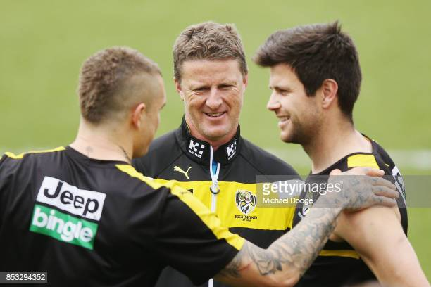 Tigers head coach Damien Hardwick talks with Dustin Martin and Trent Cotchin of the Tigers during a Richmond Tigers AFL media oportunity at Punt Road...