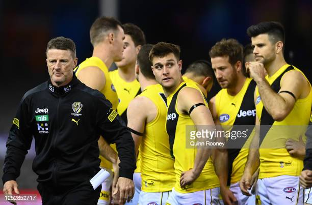 Tigers head coach Damien Hardwick walks away from speaking to his players during the round 4 AFL match between the St Kilda Saints and the Richmond...