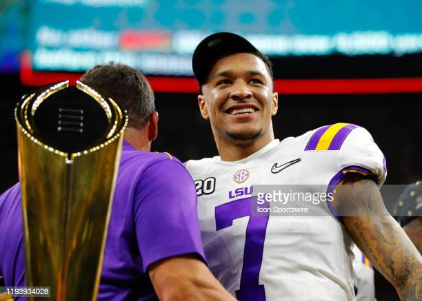 Tigers head coach Ed Orgeron celebrates with LSU Tigers safety Grant Delpit following the College Football Playoff National Championship Game between...