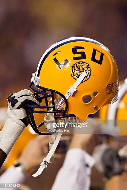 Tigers helmet is held up after a game against the Arkansas Razorbacks at Tiger Stadium on November 25 2011 in Baton Rouge Louisiana The Tigers...