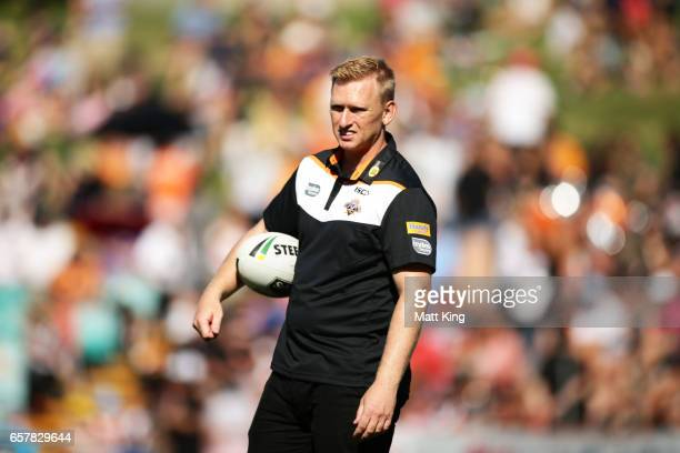 Tigers interim coach Andrew Webster takes part in warm up before the round four NRL match between the Wests Tigers and the Melbourne Storm at...