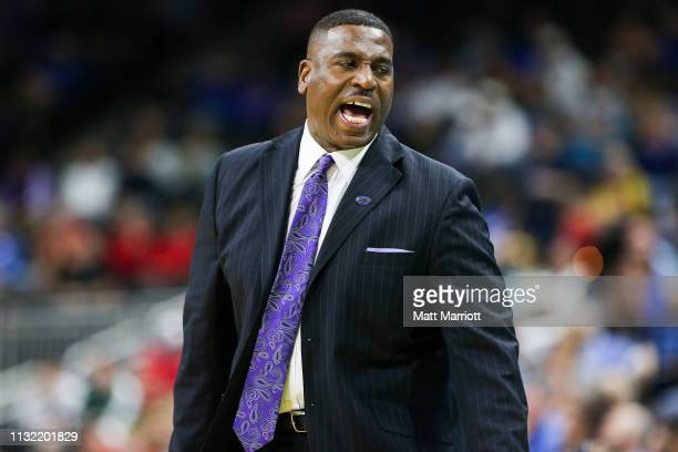 Tigers interim head coach Tony Benford coaches from the bench during a game against the Maryland Terrapins at VyStar Veterans Memorial Arena on March...