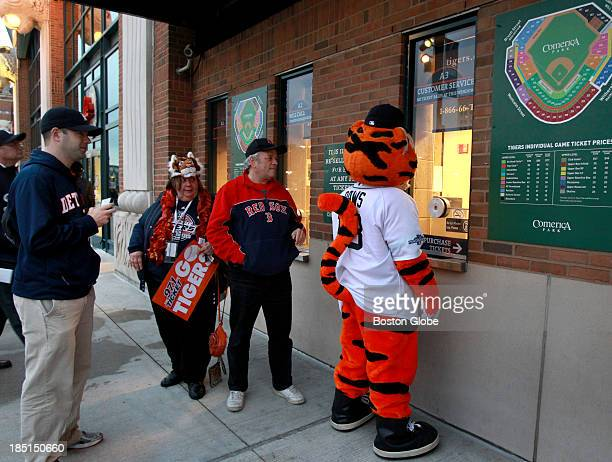 Tigers mascot Paws seems to be negotiating for tickets outside Comerica Park before Game Five of the American League Champion Series between the...