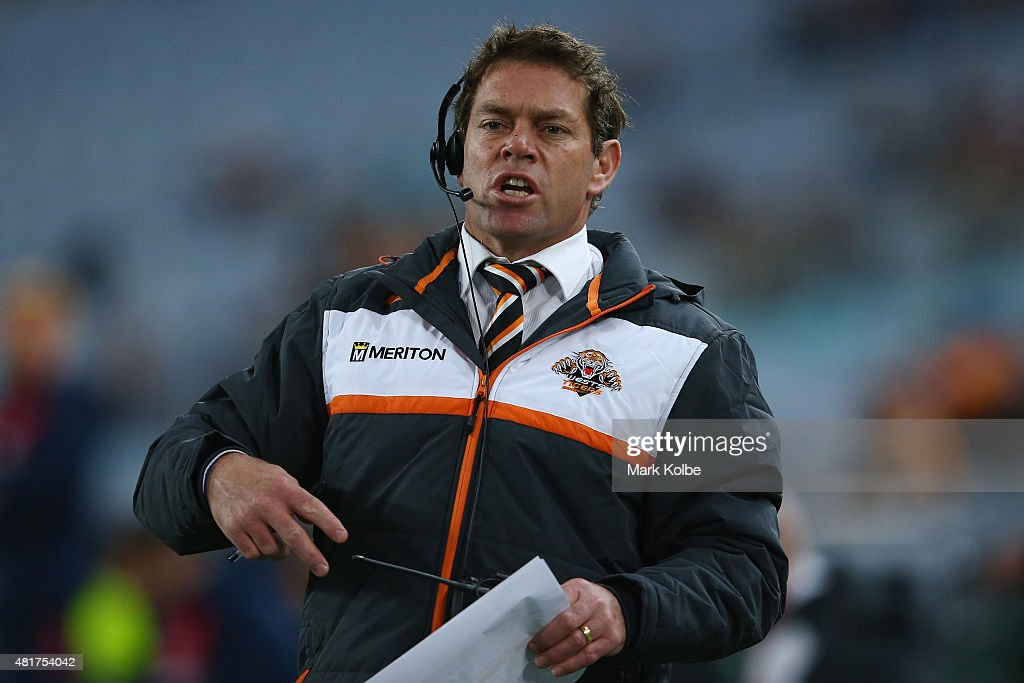 Tigers NYC coach Brett Kimmorley gives instructions from the bench during the round 20 NRL match between the Wests Tigers and the Sydney Roosters at ANZ Stadium on July 24, 2015 in Sydney, Australia.