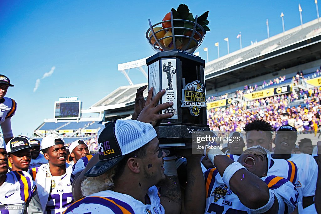 LSU Tigers players celebrate after defeating the Louisville Cardinals 29-9 in the Buffalo Wild Wings Citrus Bowl at Camping World Stadium on December 31, 2016 in Orlando, Florida.