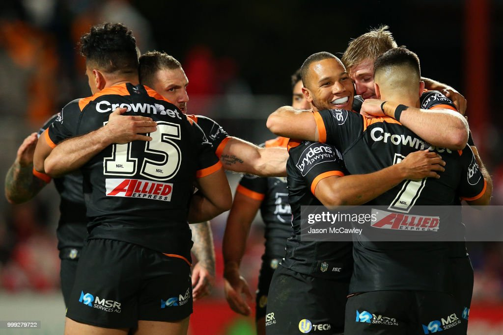 Tigers players celebrate after full time after winning the round 18 NRL match between the St George Illawarra Dragons and the Wests Tigers at UOW Jubilee Oval on July 15, 2018 in Sydney, Australia.